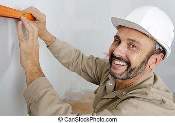 workmen align wall