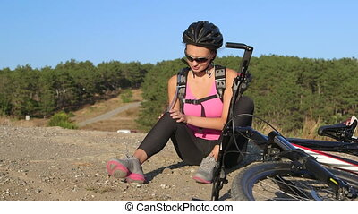 Workout fitness injuries woman cyclist with pain in knee joint after cycling