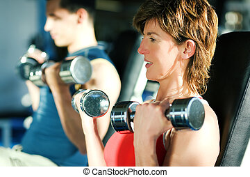 Workout with dumbbell training in gym