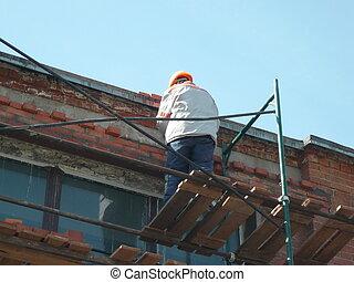 workpeople on ledge