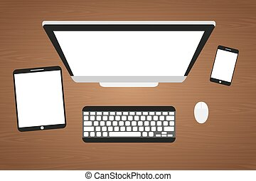 Workplace at a wooden table. Monitor, keyboard, computer mouse, tablet and smartphone