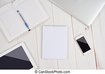 Workplace business. blank empty notebook, laptop, tablet pc, mobile phone, pen