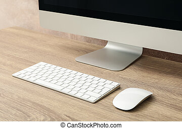 Workplace. Computer, keyboard and mouse on wooden table, close up