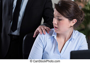 Workplace harassment - Young attractive woman and workplace...