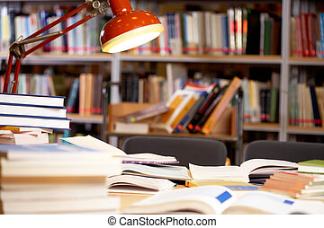 Workplace - Image of place in library: table with lamp and...