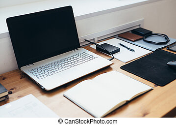 Workplace in office space. Work desk accessories