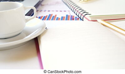 Workplace of a businessman. Notebook, pen, coffee cup and other accessories on the desk.