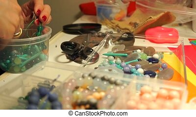Workplace of a necklace artist, side shallow focus view clip
