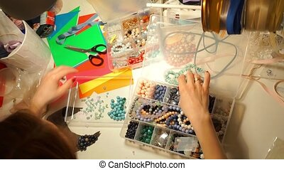Workplace of a necklace artist, view from above