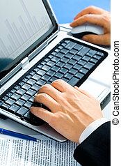 Workplace - Typical image of hands typing on a laptop