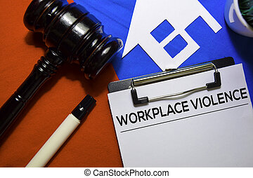 Workplace Violence text on Document form and Gavel isolated on office desk.