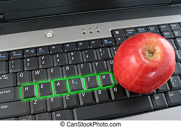 workplace wellness - the word health glowing on a laptop...