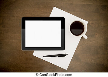 Blank digital tablet with paper, pen and cup of coffee on worktable.