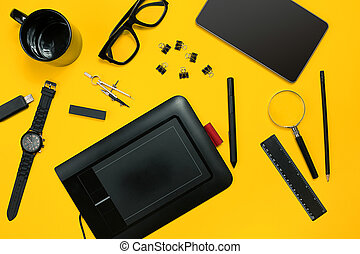 Workplace with office items and business elements on a desk. Con