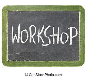 workshop word in white chalk handwriting on a vintage slate blackboard, isolated on white