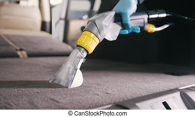 Workshop - cleaning of vehicle wardrobe with vacuum cleaner,...