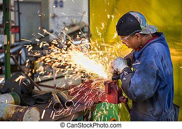 Workshop labour - A service repairmen labouring in workshop ...