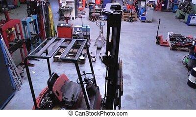 Workshop Lift - Vertical dolly up through a large mechanics...