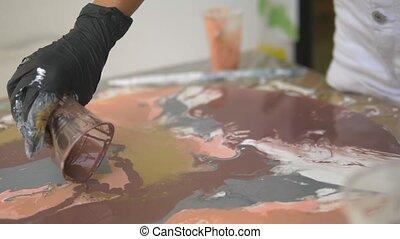 Workshop of liquid acrylics. Fluid art. female hands pouring...