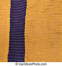 yellow textile background from stitched strips