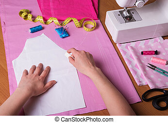 Workshop seamstress. Handmade. Cutting out the fabric pattern