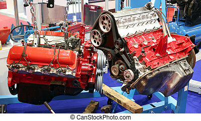 workshop with car engines and parts