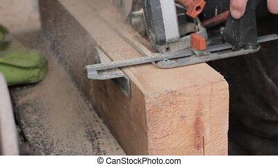 Workshop workers use wood saw machine. wood sawing.