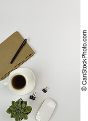 Workspace compositon  with, coffee cup,notebook,pen ,computer mouse and green leaves pot with space on white background,top view