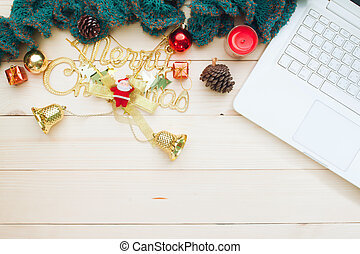 Workspace in Christmas style concept with white laptop, Decorative ornaments on wooden background