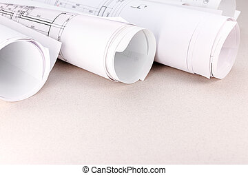 rolls of blueprints and architectural drawings