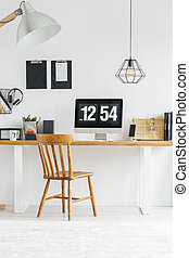 Workspace with white wall