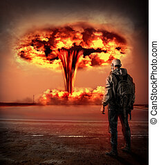 World Apocalypse. Man in gas looking on big red mushroom of Nuclear explosion outdoor. environmental protection concept and the dangers of nuclear energy.