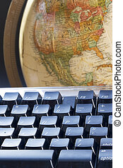 World at fingertips - Computer keyboard and earth globe