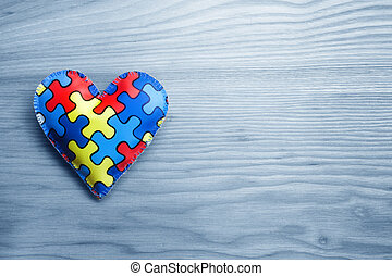 World Autism Awareness day, mental health care concept with puzzle or jigsaw pattern on heart