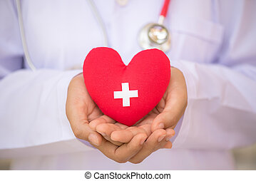 World Blood Donor Day, June 14. Doctor hands holding red heart with donor sign. Healthcare And Medical concept.