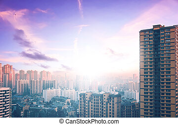 World Cities Day concept: city skyline at sunset background