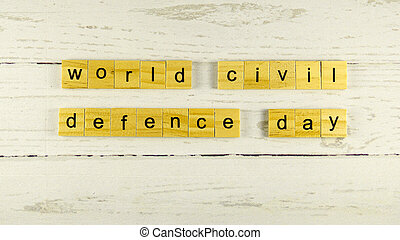 World Civil Defence Day.words from wooden cubes with letters
