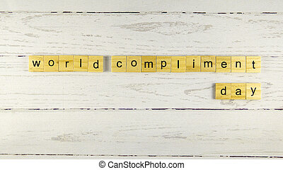World Compliment Day.words from wooden cubes with letters