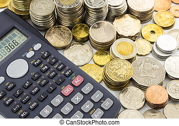 world currency coins and calculator