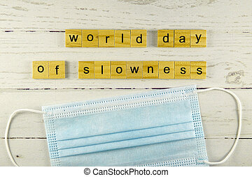 world day of slowness.words from wooden cubes with letters