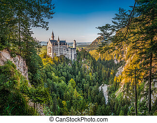 Beautiful panoramic view of world-famous Neuschwanstein Castle with steep poellat canyon in beautiful evening light at sunset, Fussen, southwest Bavaria, Germany