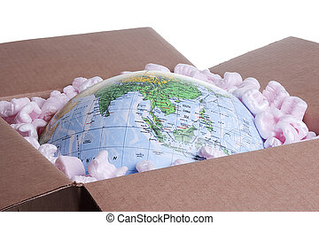 World in a Box - Close-up of a globe in a delivery box.