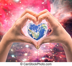 World in heart shape with over women human hands on blurred natural background: World Heart health day,Element of this image furnished by NASA