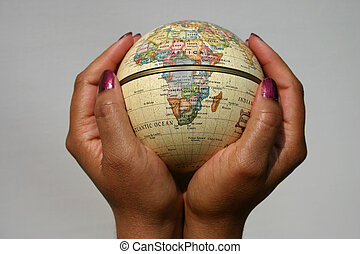 conceptual image of female holding a globe, Africa to the forefront, could be used to illustrate many global/power issues