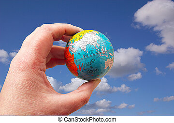 world in your hand - the world at your fingertips against a...