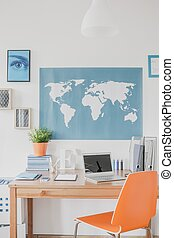 World map above the desk in study room