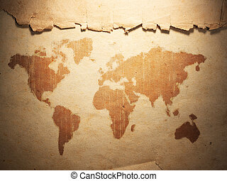 world map displayed on the corrugated old paper. Close up