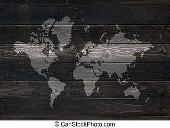 World map on black wooden wall background