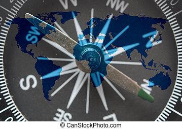 world map on glass compass