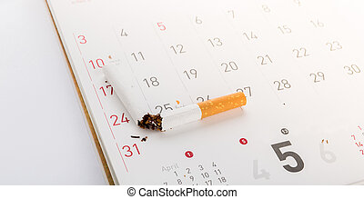 World No Tobacco Day : Broken cigarette on calendar ,sun ...